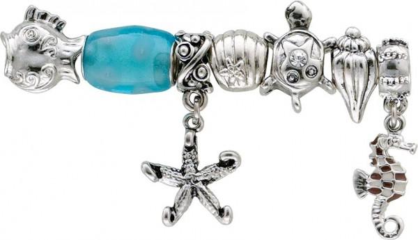 Beadset 7-teilig aus unserer Crystal Blue-Collection, teils mit Elementen aus Glas, Kristallstrassteinen und auch mit funkelnden Zirkonia besetzt. Verschiedene Beads, passend für alle Sammelsysteme aus Metall im angesagten Pandorra Stil zu